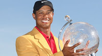 Tiger Woods holding a trophy