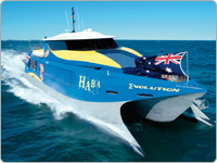 Haba Great Barrier Reef Adventure Cruise Vessel Gliding Through the Ocean Off Port Douglas