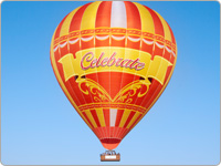 Elaborate Orange and Yellow Hot Air Balloon Featuring the Word Celebrate on a Blue Sky Background