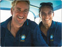 Close-up of Two Smiling Crew Members of Sailaway Great Barrier Reef Tours Port Douglas
