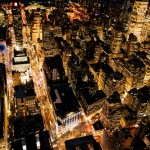 Photograph of Bright Lights of a City Taken From Above at Night