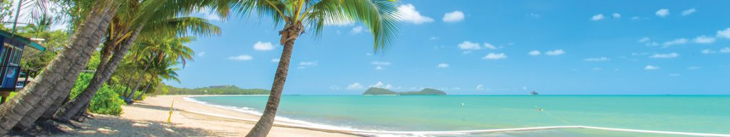 View of Mission Beach with Palm Trees and Lizard Island in Cairns in Far North Queensland