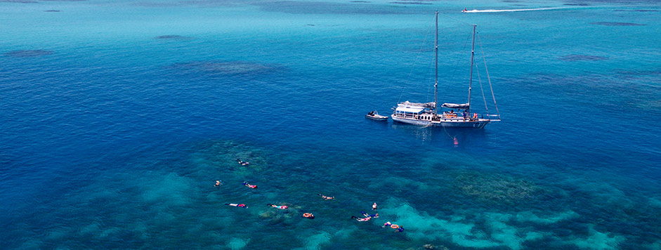 Sailboat and Snorkellers on the Great Barrier Reef