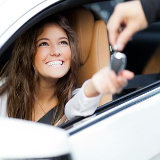 Young woman receiving keys